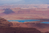Potash ponds in the distance as seen from Dead Horse Point. They're kind of an unnatural blight on the pristine desert landscape, but on the other hand, their radiant blue colour makes them actually kind of pretty.
