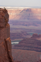Just beyond the deck, the sheer rock wall drops thousands of feet to the canyon floor
