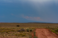 Near Canyonlands National Park, with a storm brewing beyond Moab to the northeast