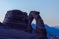 The first light of the morning is just touching the top of Delicate Arch