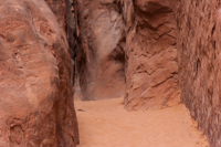 Soft orange-red sand in a narrow canyon along the Landscape Arch trail