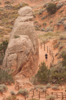 Looking down from along the Double O Arch trail as a visitor approaches Landscape Arch
