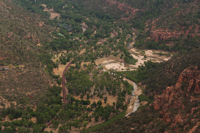 A telephoto image of the valley floor from Angels Landing. I've never been to Australia, but the red stone and foliage made me feel very much as though I was there. Even the asphalt in the road is red.